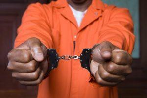 Handcuffed criminal in court